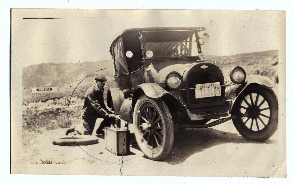 Fixin a Flat Tire by William Cresswell